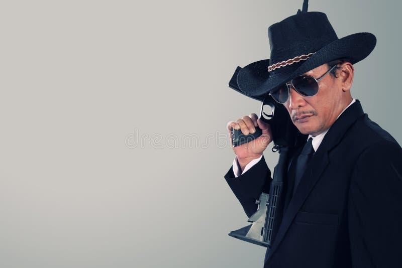 Gammal gangster med copyspace fotografering för bildbyråer