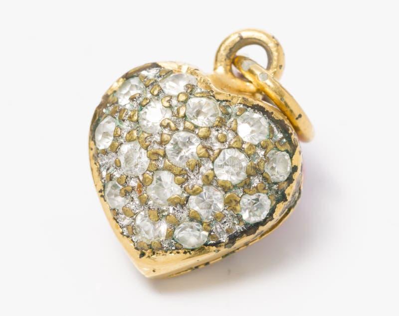 Gammal Gemstone i den hjärtaShape medaljongen royaltyfri fotografi