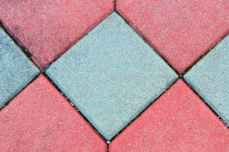 Gammal geometritextur för kvarter, bakgrund för cement för stentegelstengolv härlig arkivbilder