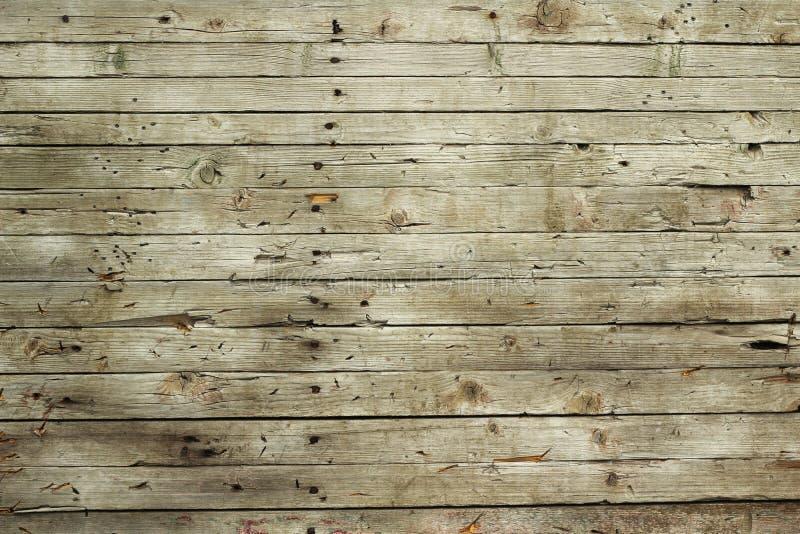 Gammal grå rutten wood plankabakgrund royaltyfri bild