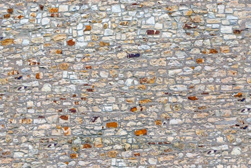 Gammal grå stenvägg för sömlös textur royaltyfri bild