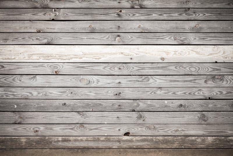Gammal grå trävägg, bakgrundstextur royaltyfri foto