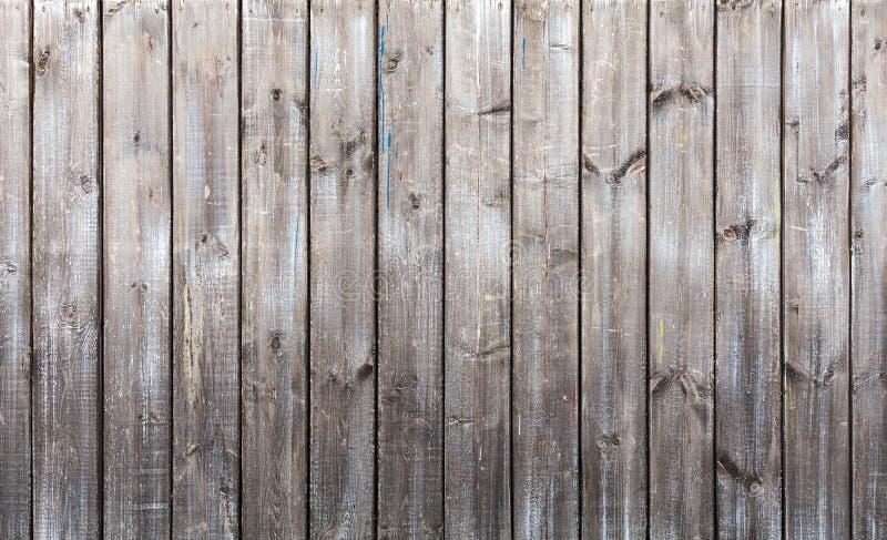Gammal grå trävägg, bakgrundstextur arkivbilder