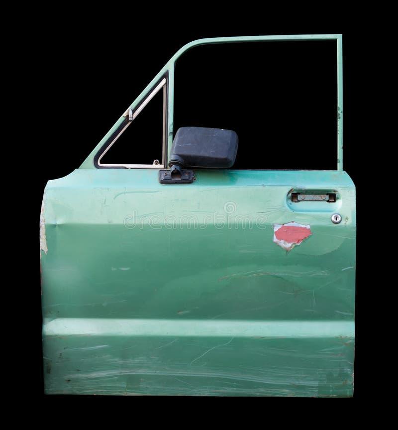 Gammal grön bildörr för isolat arkivbilder