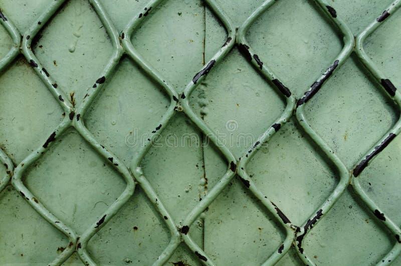 Gammal grön metallbakgrund arkivfoton