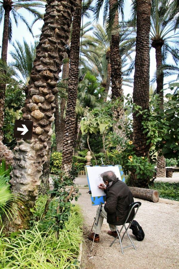 Gammal hög målning i den Huerto del Cura trädgården arkivbild