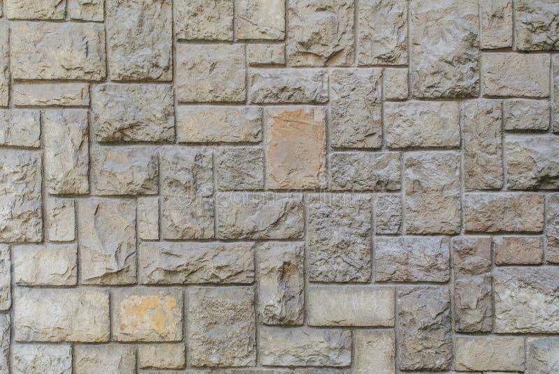Gammal huggen ut stenv?gg, h?rlig bakgrundstextur arkivfoton