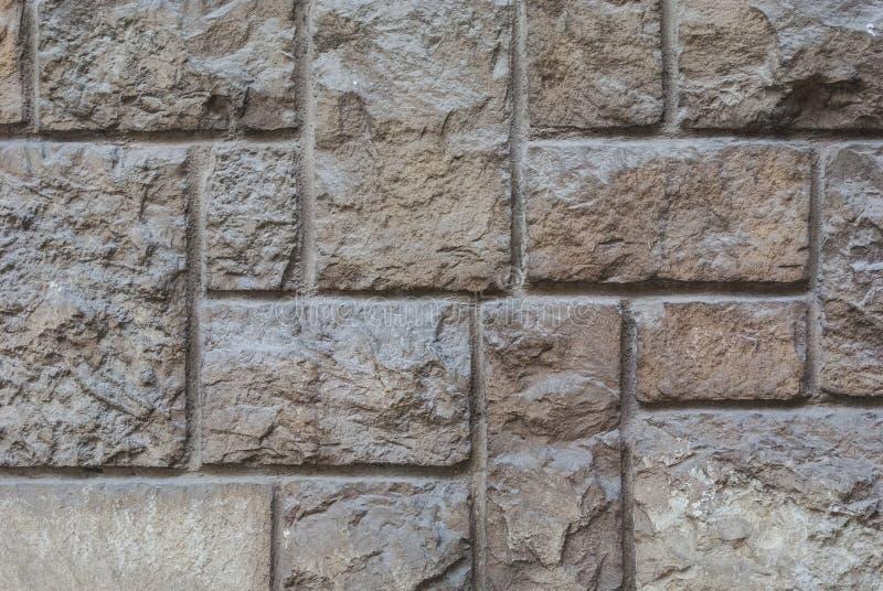 Gammal huggen ut stenv?gg, h?rlig bakgrundstextur royaltyfria bilder