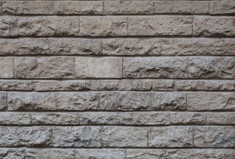 Gammal huggen ut stenv?gg, h?rlig bakgrundstextur royaltyfri bild