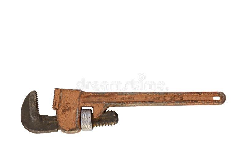 Gammal justerbar rörskiftnyckel på en vit bakgrund royaltyfri foto