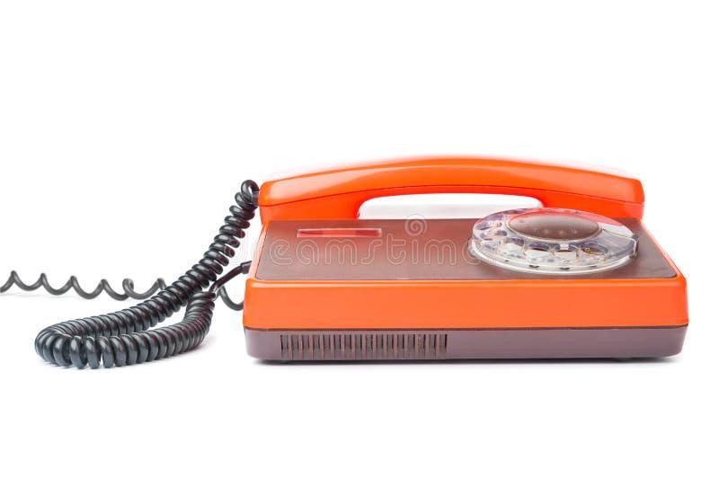 Gammal klassisk orange telefon fotografering för bildbyråer
