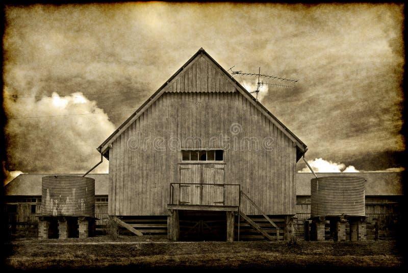 gammal ladugårdbyggnad arkivbild