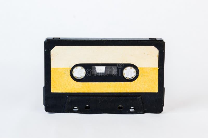 Gammal ljudkassett som isoleras på vit bakgrund Historisk reco royaltyfri fotografi