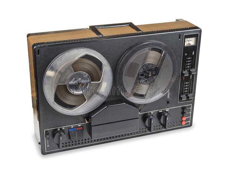 Gammal ljudsignal magnetisk bandspelarerulle som reel från seventies arkivbild