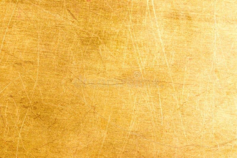 Gammal mässing pläterar texturerar arkivfoto