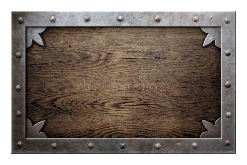 Gammal metallram över träbakgrund arkivfoto