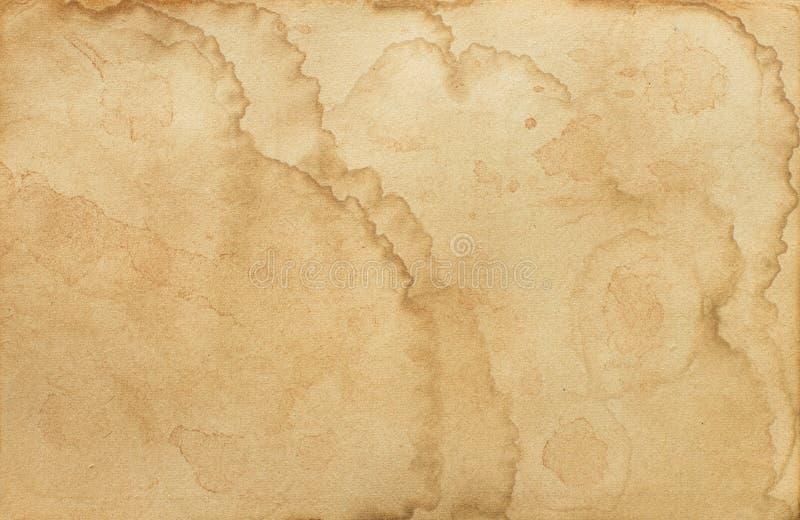 Gammal nedfläckad pappers- textur royaltyfri foto