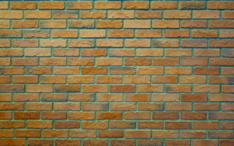 Gammal Pale Orange Green Brick Wall textur för prydnadpapper för bakgrund geometrisk gammal tappning royaltyfri foto