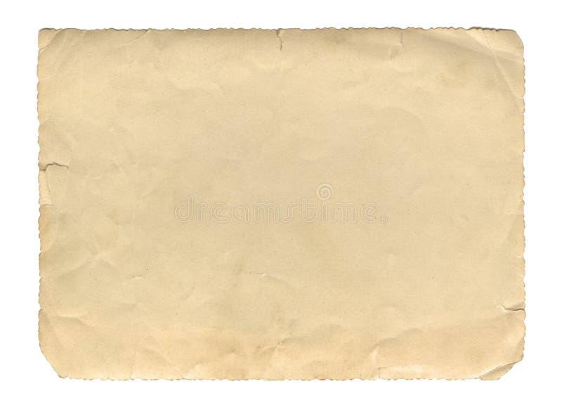 Gammal pappers- textur eller bakgrund för tappningstilbrunt, med ojämna sönderrivna kanter royaltyfria foton
