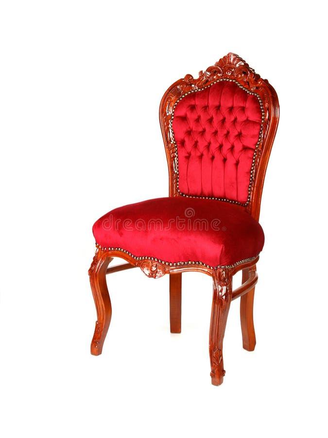 gammal röd stilsammet för stol fotografering för bildbyråer