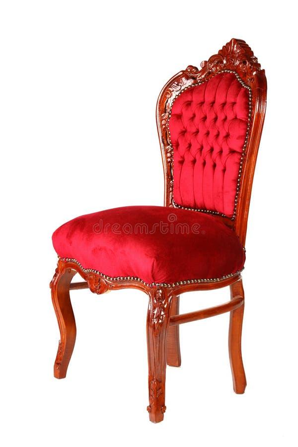 gammal röd stilsammet för stol arkivbilder