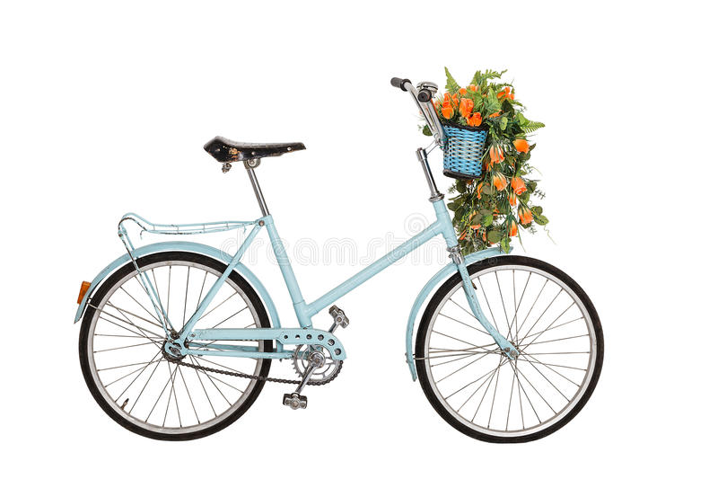 Gammal retro cykel med blommor arkivbild