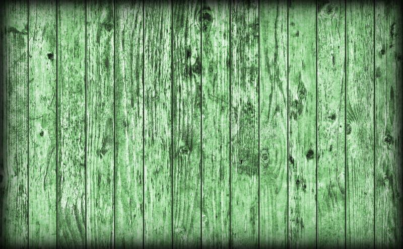 Gammal riden ut lantlig knuten gräsplan sörjer för Vignetted för träplank grov textur Grunge royaltyfri foto