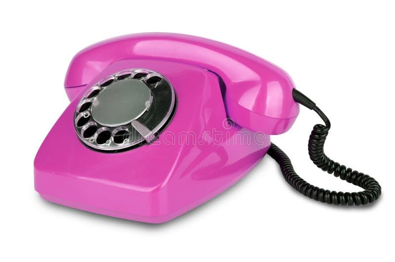 Gammal rosa färgtelefon royaltyfria foton