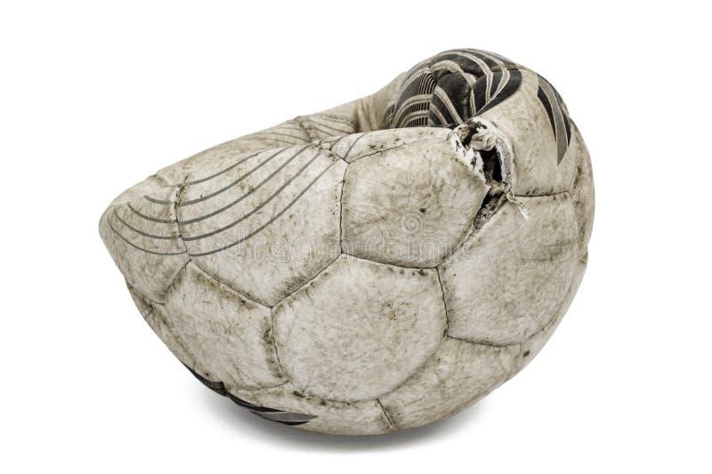 Gammal sönderriven fotbollboll som isoleras på vit bakgrund royaltyfri fotografi