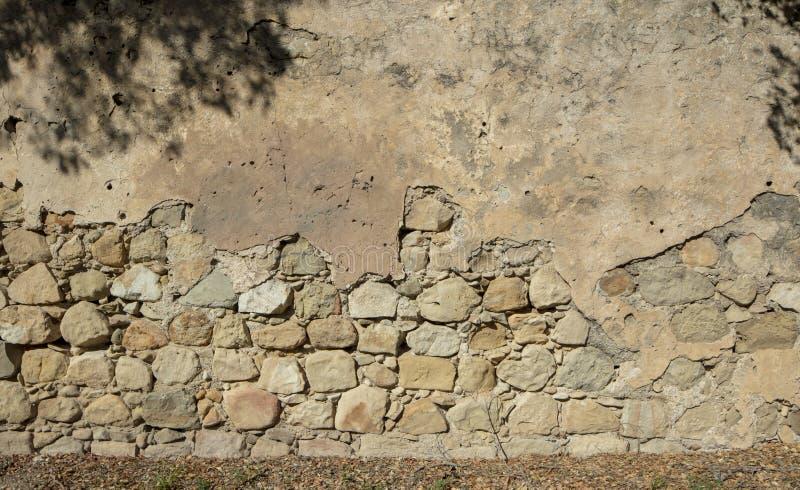 gammal sandsten för bakgrund som använder väggen arkivfoto