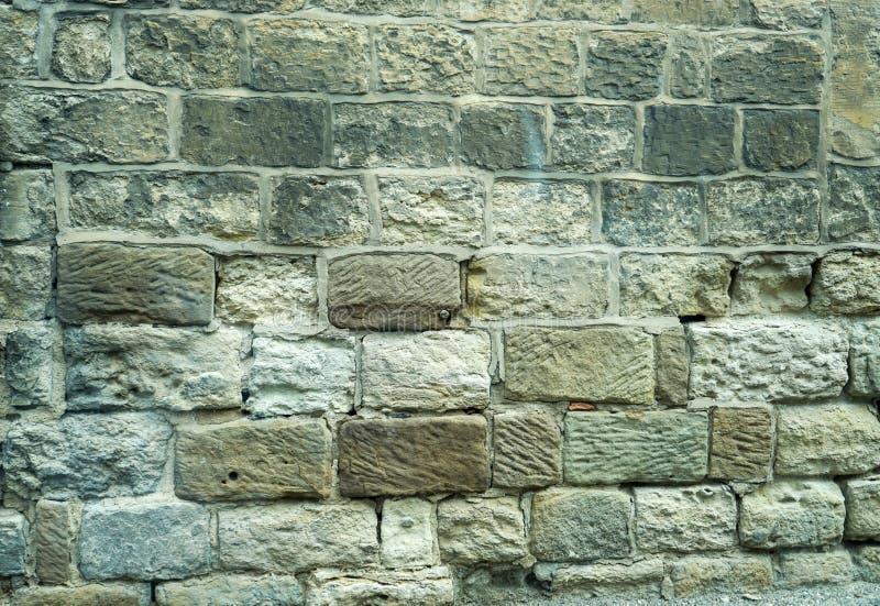 gammal sandsten för bakgrund som använder väggen royaltyfri foto