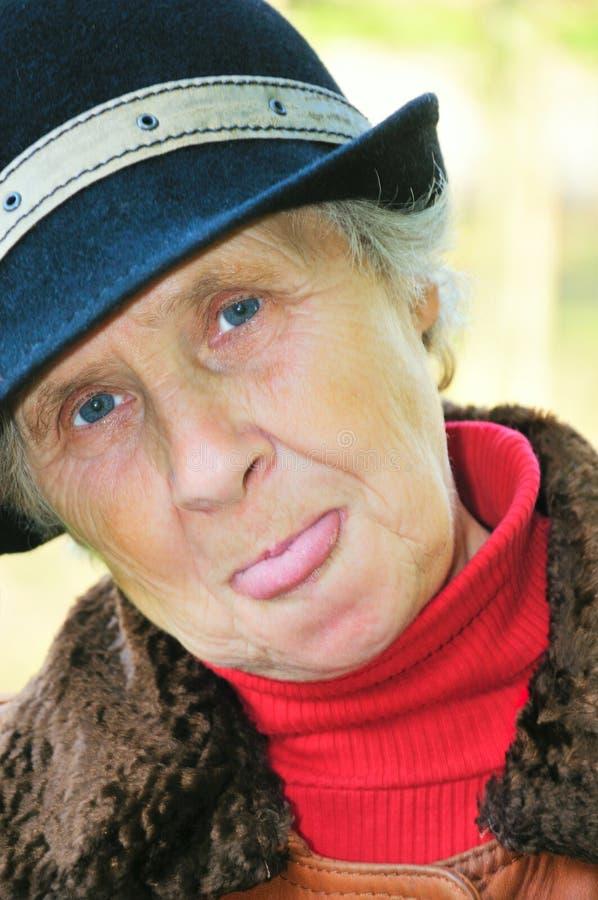 gammal showtungkvinna royaltyfri fotografi