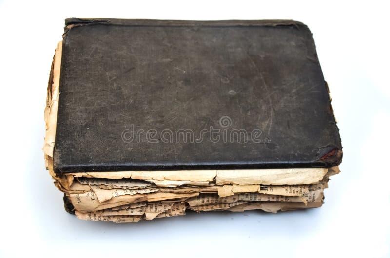 Gammal sjaskig antik ` för bok`-bibeln på vit isolerade bakgrund arkivfoto