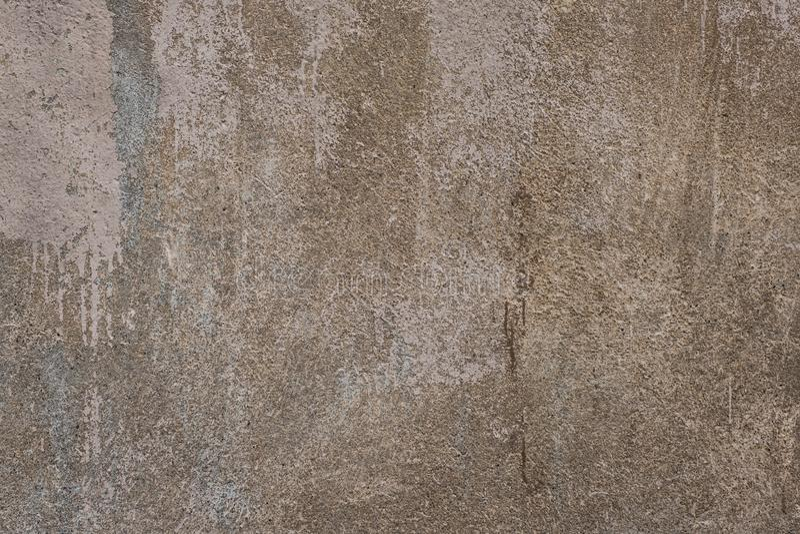 Gammal sjaskig packad ljus v?gg, texturerad cementv?gg royaltyfria foton