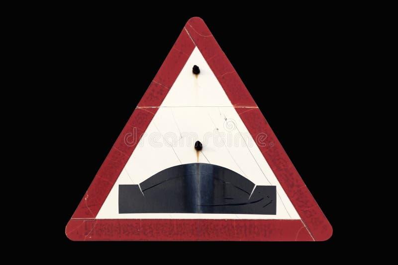 Gammal smutsig rostig triangulär röd ` för knöl för gränsvägmärke`, arkivbilder