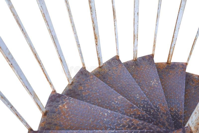 Gammal smutsig trappa för rostigt järn som går ner isolerat på vit royaltyfria bilder