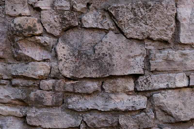 Gammal stenv?gg forntida v?gg murverktextur, stenhuggeriarbetemodellbakgrund royaltyfria foton