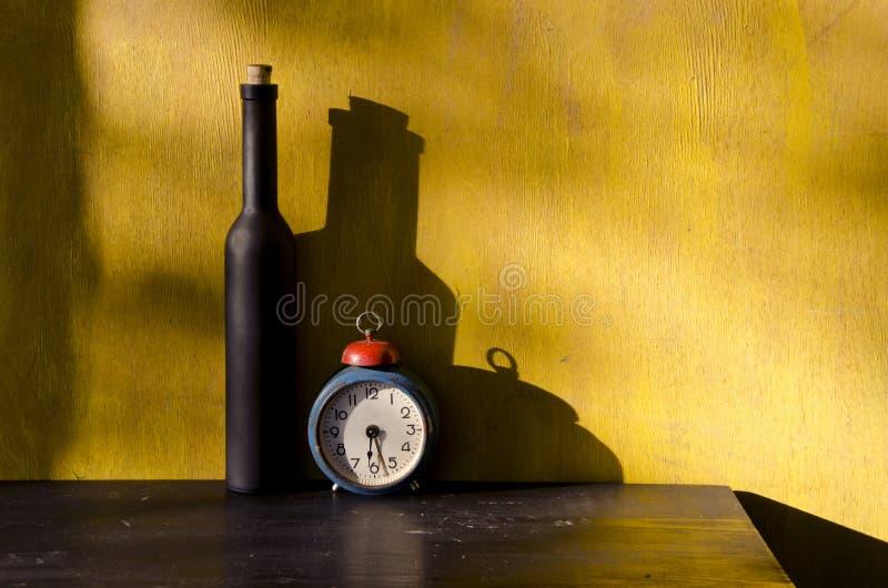 gammal stiil för svart flaskklockalivstid arkivfoton