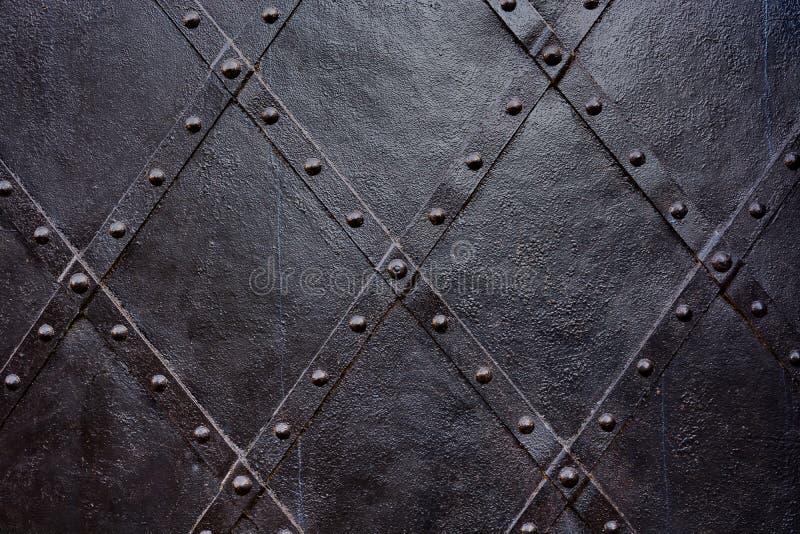 Gammal svart järndörrbakgrund, textur, tapet, modell arkivfoto