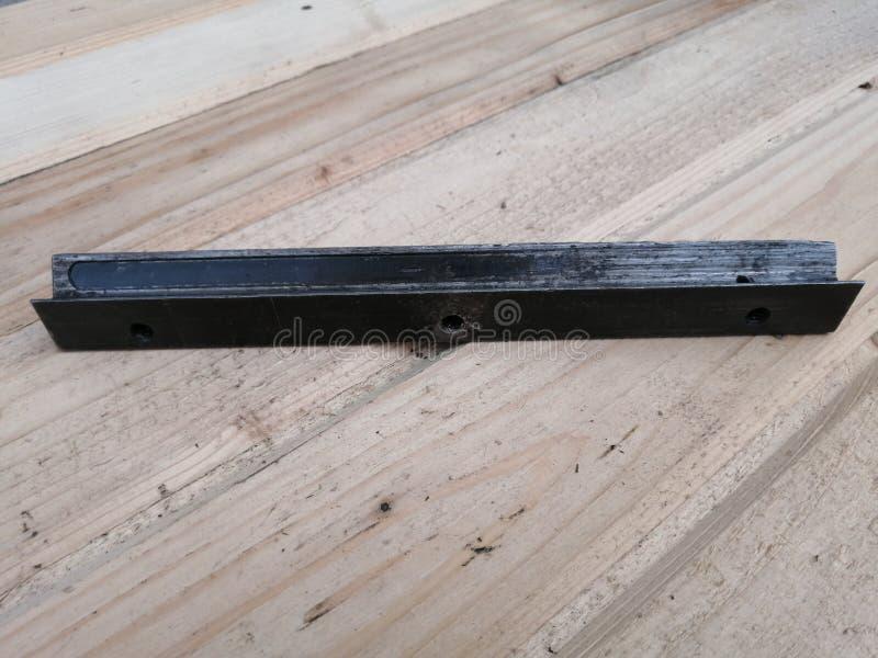 Gammal svart remsa för järn för metallprodukt royaltyfri bild