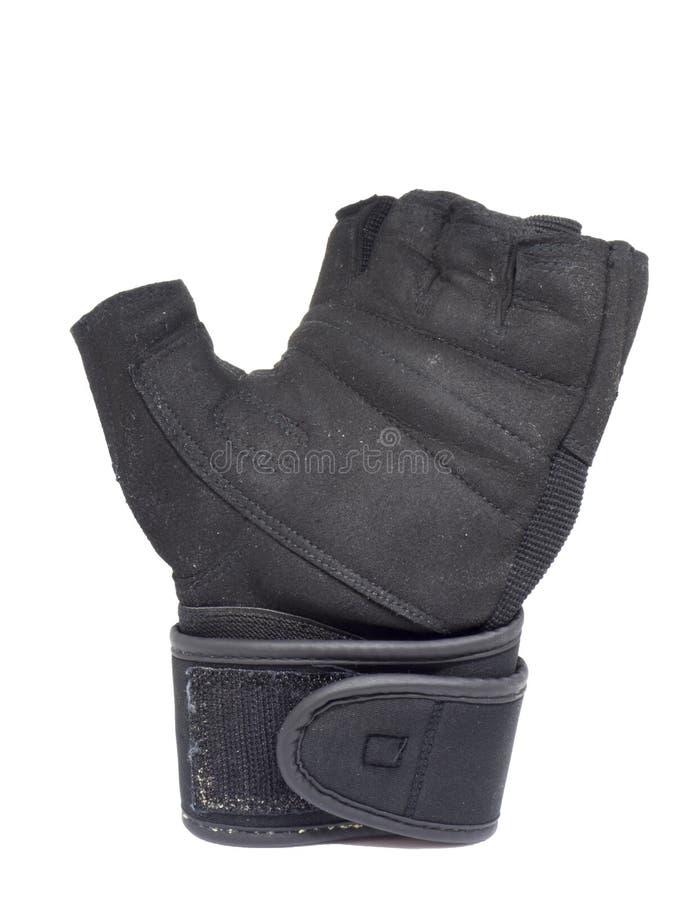 Gammal svart vänster handkonditionhandske på isolerad vit bakgrund arkivbild