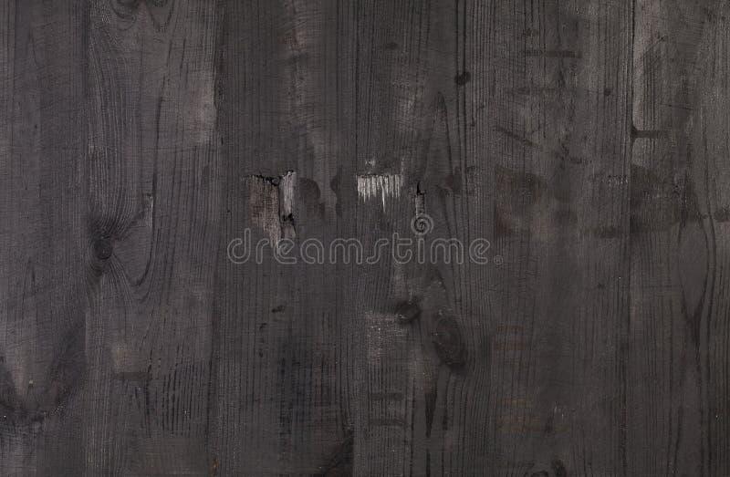 Gammal svart wood bakgrund, lantlig träyttersida arkivfoto