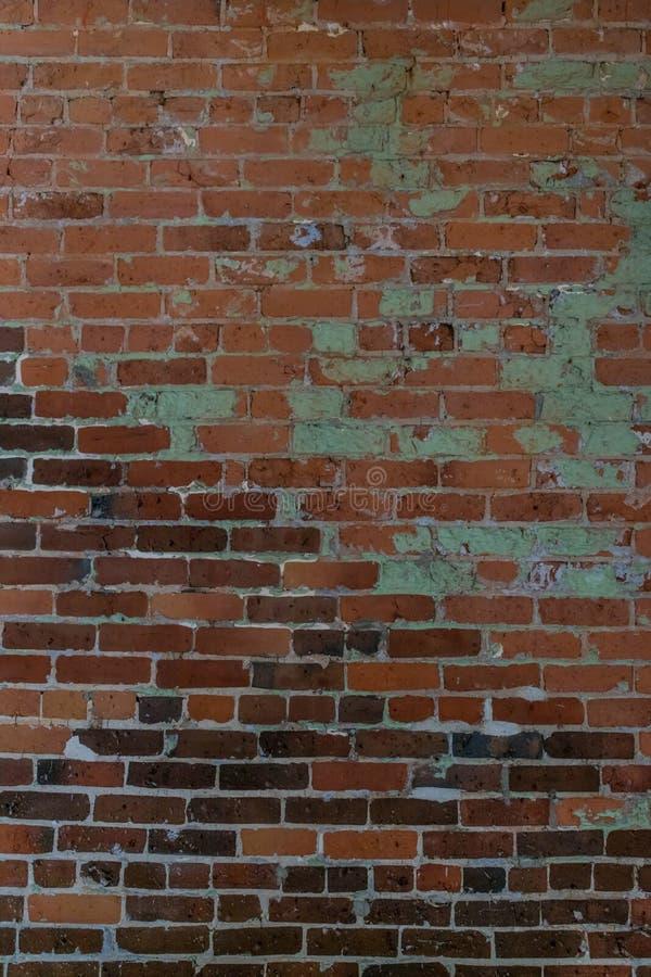 Gammal tegelstenvägg för bruk som bakgrund royaltyfri bild