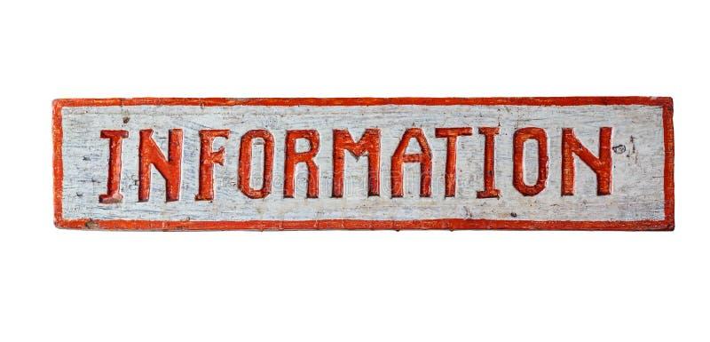 Gammal träplatta med inskriften, information som isoleras på fotografering för bildbyråer