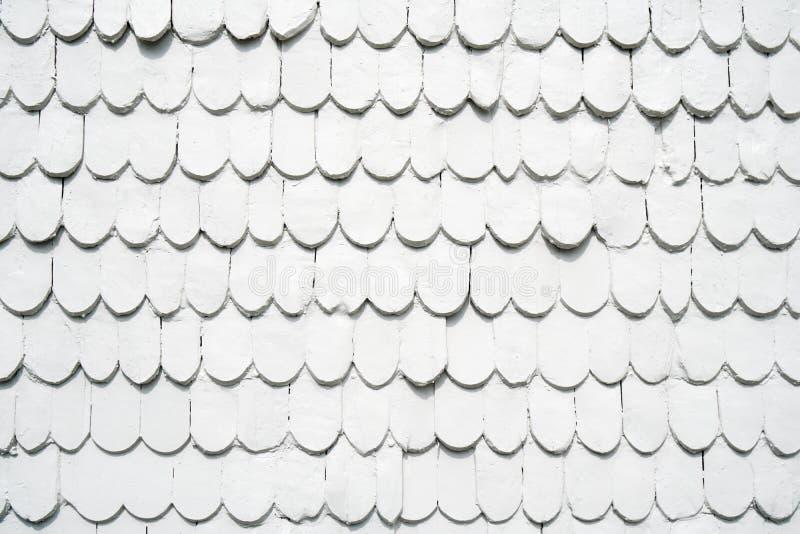 Gammal träsid för singlar målade vitt arkivbild