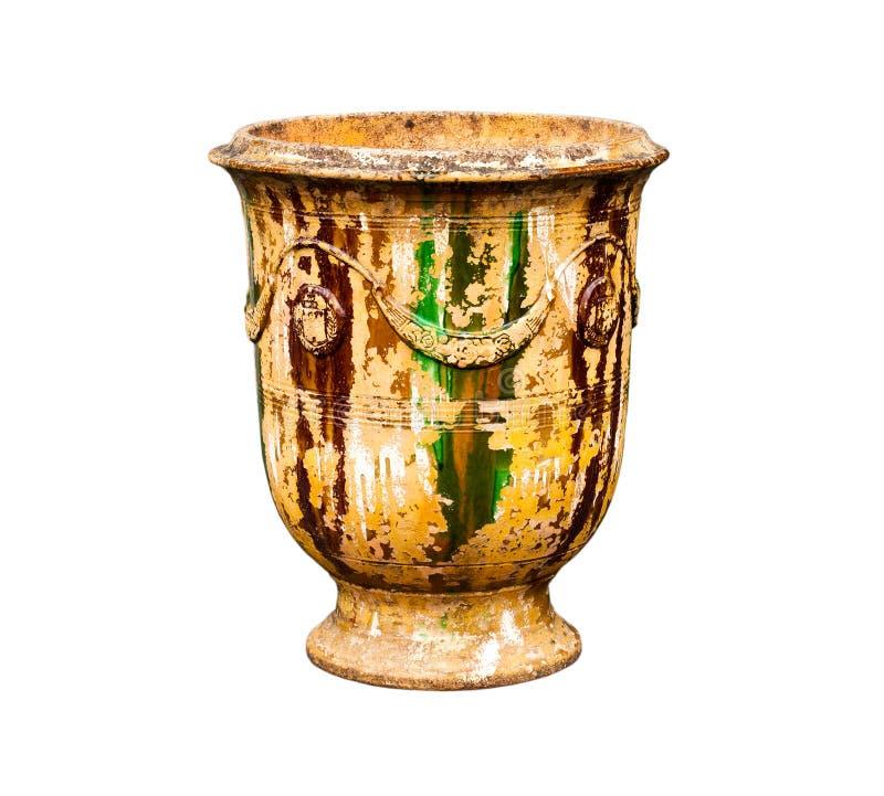 Gammal urnavas på en vit bakgrund royaltyfria foton