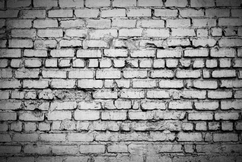gammal vägg för tegelsten Svartvitt foto med vignettingeffekt arkivfoto