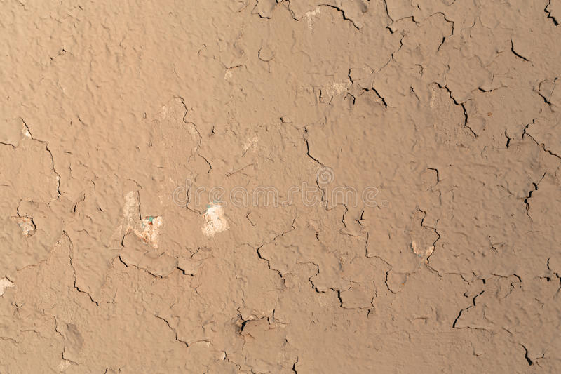 Gammal vägg som täckas med murbrukmörkerskuggor arkivfoto