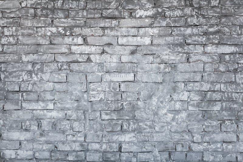 Gammal vit-grå färger tegelstenvägg fotografering för bildbyråer