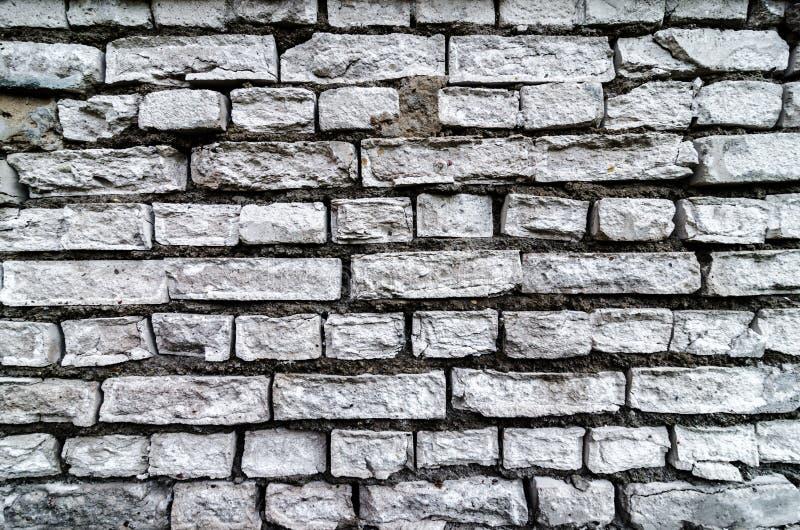 Gammal vit texturerad bakgrund för tegelstenvägg TappningBrickwall fyrkant kalkad textur Tvättad murverkyttersida för Grunge vit  royaltyfri foto